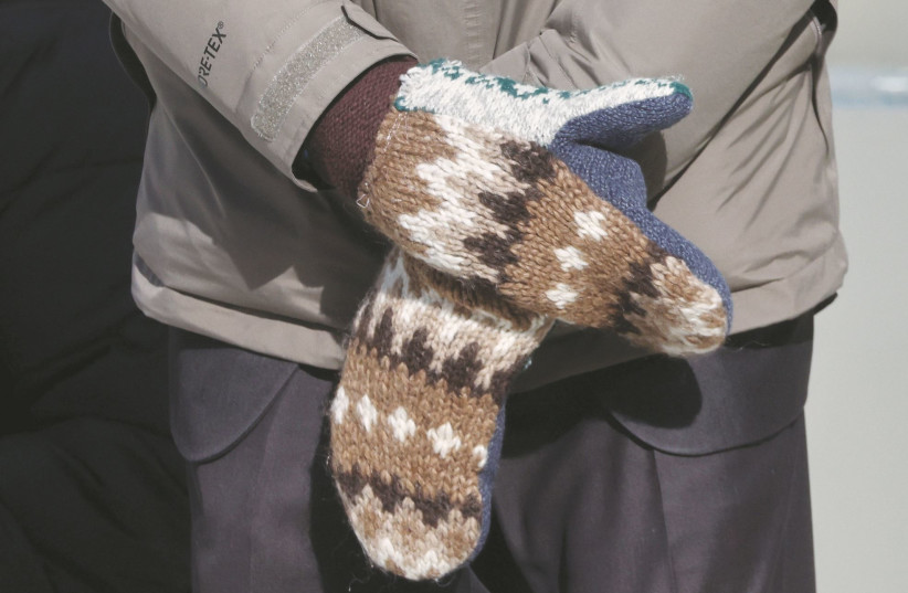 Sen. Bernie SANDERS with his now famous mittens at the inauguration of US President Joe Biden on January 20. (photo credit: JONATHAN ERNST/POOL/REUTERS)