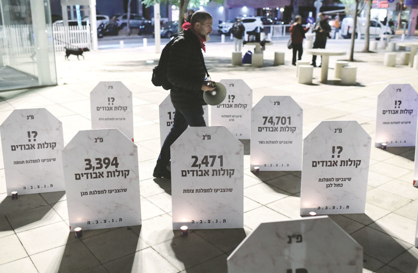 MOCK GRAVESTONES mark a protest in Tel Aviv two weeks ago calling for left-wing and centrist parties to unite ahead of the elections. (photo credit: TOMER NEUBERG/FLASH90)