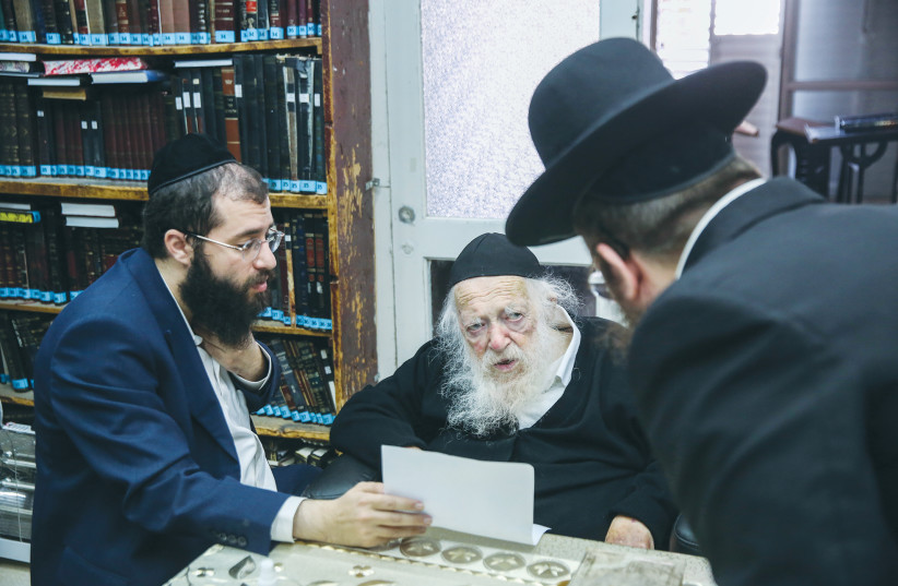 RABBI CHAIM KANIEVSKY speaks with students at his home in Bnei Brak in December. (photo credit: DAVID COHEN/FLASH 90)