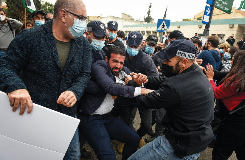 POLICE SCUFFLE with Arab-Israelis in Nazareth during a protest against Prime Minister Benjamin Netanyahu's visit to the city earlier this month. (photo credit: RONI OFER/FLASH90)