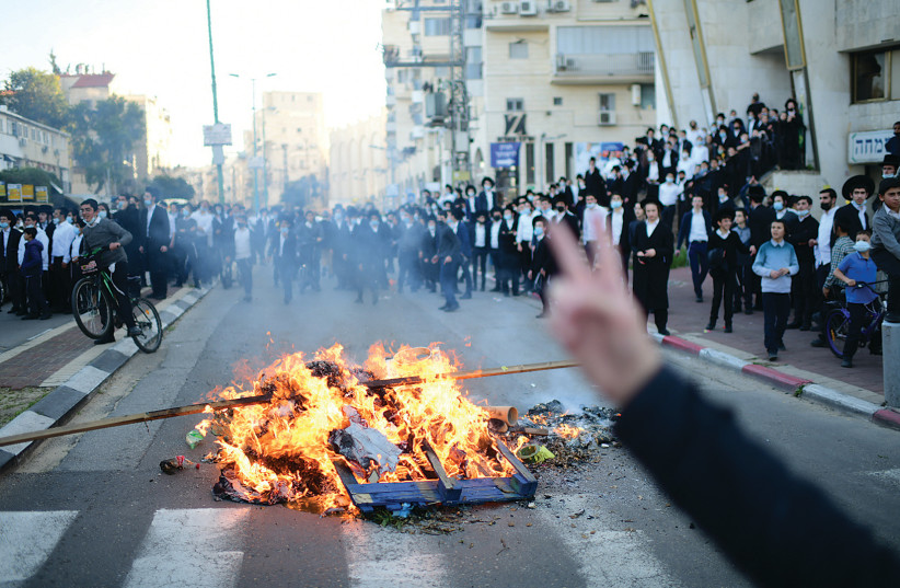 HAREDIM STAGE a fiery protest in Bnei Brak on Sunday. (photo credit: TOMER NEUBERG/FLASH90)