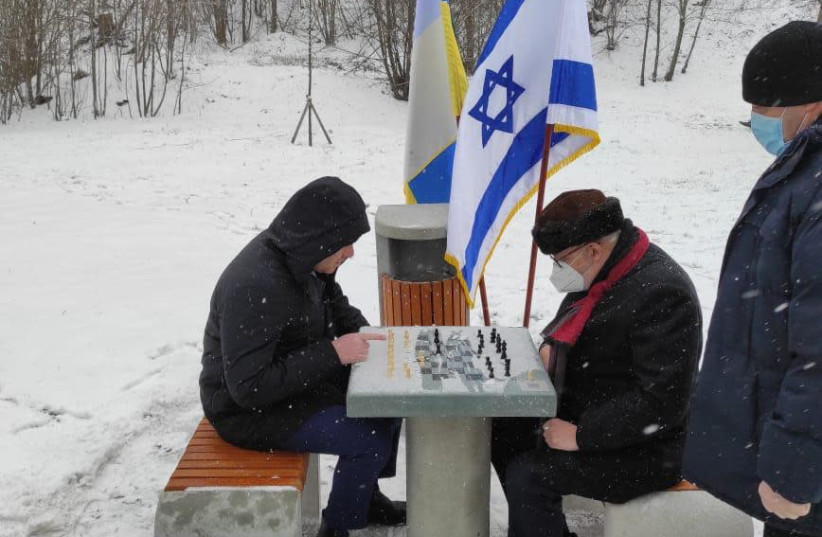 Park-goers play chess at the chess tables donated by the Israeli embassy in Kiev to mark 30 years to Israeli-Ukrainian diplomatic ties, January 28, 2021. (photo credit: ISRAELI EMBASSY IN KIEV)