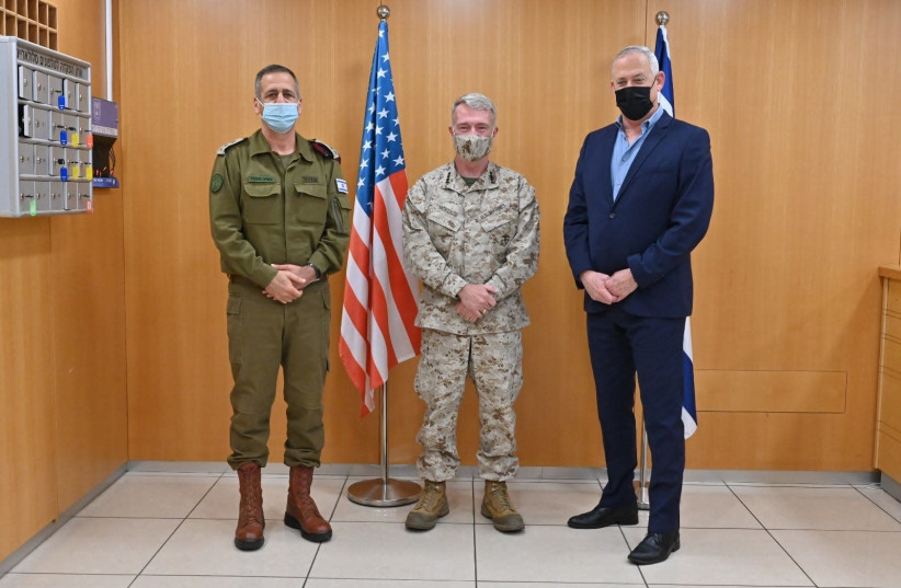 From R to L: Defense Minister Benny Gantz, Commander of the United States Central Command, General Kenneth F. McKenzie, Jr. and IDF Chief of Staff Lt.-Gen. Aviv Kochavi in Tel Aviv, January 29, 2021.  (photo credit: ARIEL HERMONI / MINISTRY OF DEFENSE)