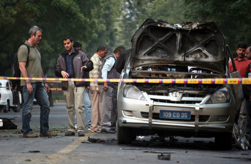 People examine a damaged Israeli embassy car after an explosion in New Delhi in 2012. (photo credit: REUTERS/PARIVARTAN SHARMA)