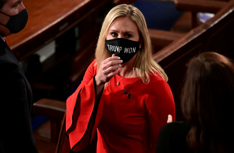 "US Rep. Marjorie Taylor Greene (R-GA) wears a ""Trump Won"" face mask as she arrives on the floor of the House to take her oath of office as a newly elected member of the 117th House of Representatives in Washington, US, January 3, 2021.  (photo credit: REUTERS/ERIN SCOTT/POOL/FILE PHOTO)"