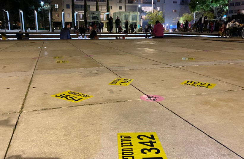 Notes scattered throughout Habima Square in Tel Aviv by protesters, symbolizing the 4,600 victims of the coronavirus in Israel, Saturday, January 30, 2021. (photo credit: SASSONI AVSHALOM)
