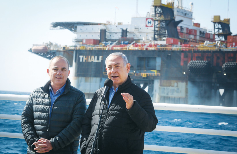 PRIME MINISTER Benjamin Netanyahu and Energy Minister Yuval Steinitz visit at the Leviathan gas field gas processing rig near Caesarea in 2019. (photo credit: MARC ISRAEL SELLEM/THE JERUSALEM POST)