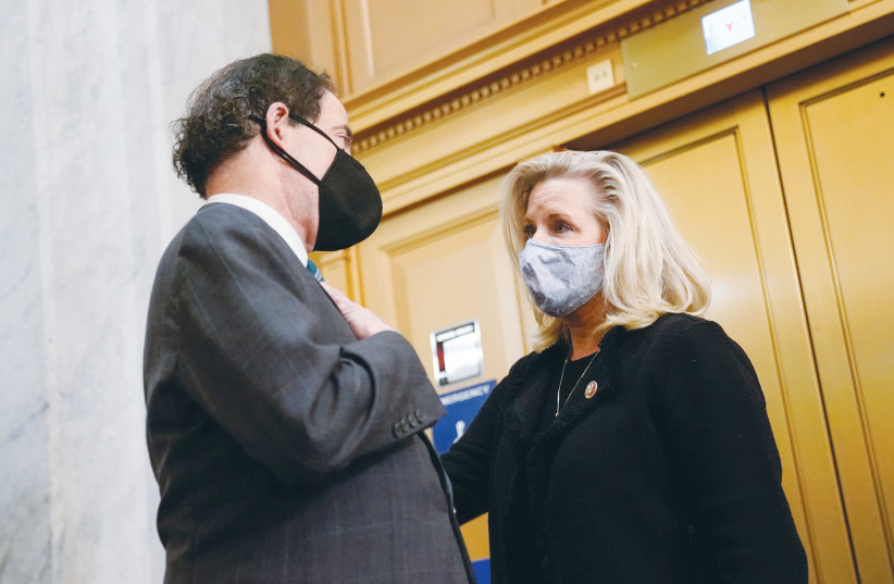 REP. JAMIE RASKIN (D-Maryland) talks with Rep. Liz Cheney (R-Wyoming) in the US Capitol on January 12. (photo credit: ERIN SCOTT/REUTERS)