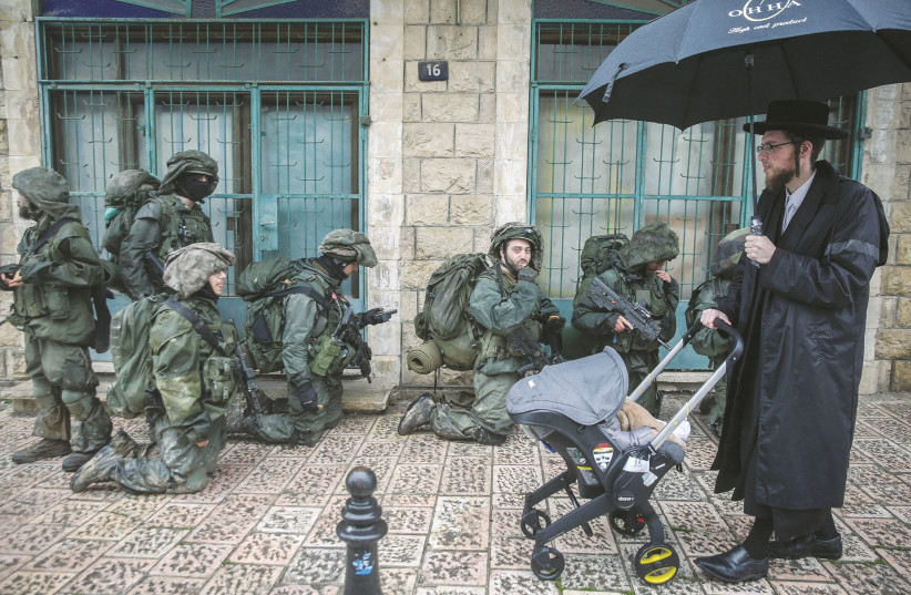 SOLDIERS FROM Battalion 51 in the Golani Brigade take part in a drill in Safed last year. (photo credit: DAVID COHEN/FLASH 90)