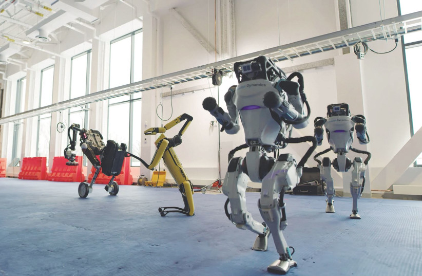 ROBOTS DANCE in a Boston Dynamics robotics company video posted on December 29. (photo credit: BOSTON DYNAMICS VIA REUTERS)