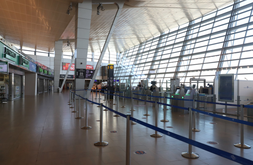 The departure hall at the almost empty Ben Gurion International Airport near Tel Aviv on January 25, 2021.  (photo credit: YOSSI ALONI/FLASH90)