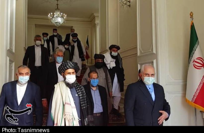 Iran FM Javad Zarif meets with Taliban delegation in Tehran, Jan. 2021 (photo credit: TASNIM NEWS AGENCY)