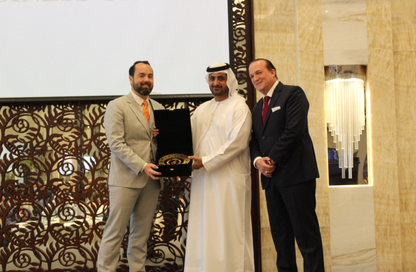 Sheikh Juma Bin Maktoum presents an award to DP World SVP Ryan Quinlan, alongside Dr. Raphael Nagel, founder of the Abrahamic Business Circle (photo credit: ABRAHAMIC BUSINESS CIRCLE)