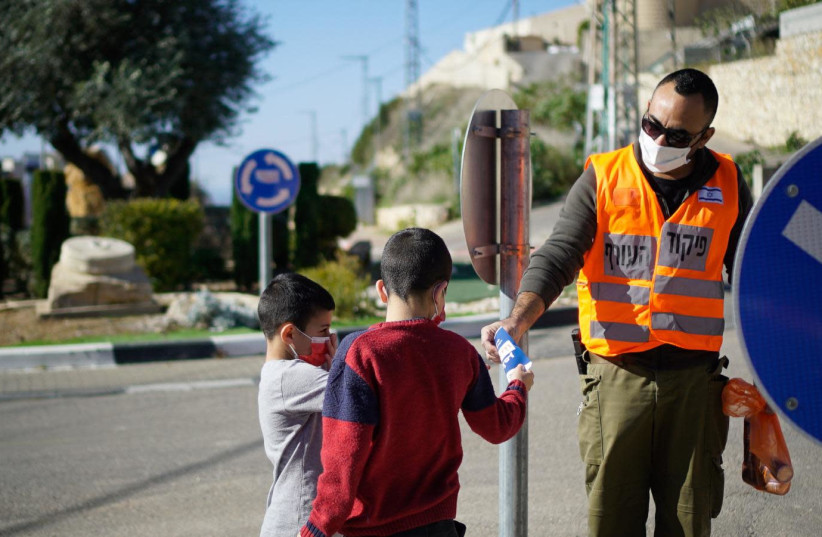 Soldiers from the IDF's Home Front Command unit distribute informative pamphlets in Arabic (photo credit: IDF SPOKESPERSON'S UNIT)