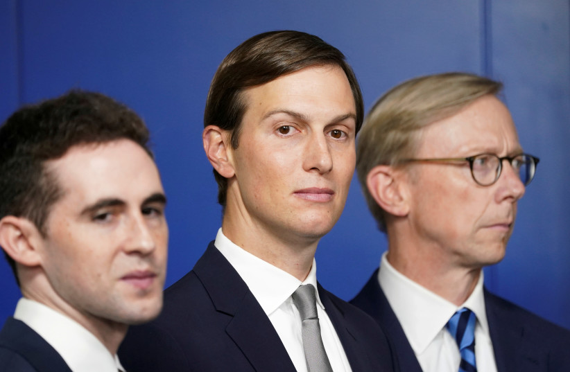 White House adviser Jared Kushner, flanked by aide Avi Berkowitz (L) and Brian Hook, former U.S. envoy to Iran, during a press briefing on the agreement between Israel and the United Arab Emirates at White House in Washington (photo credit: KEVIN LAMARQUE)