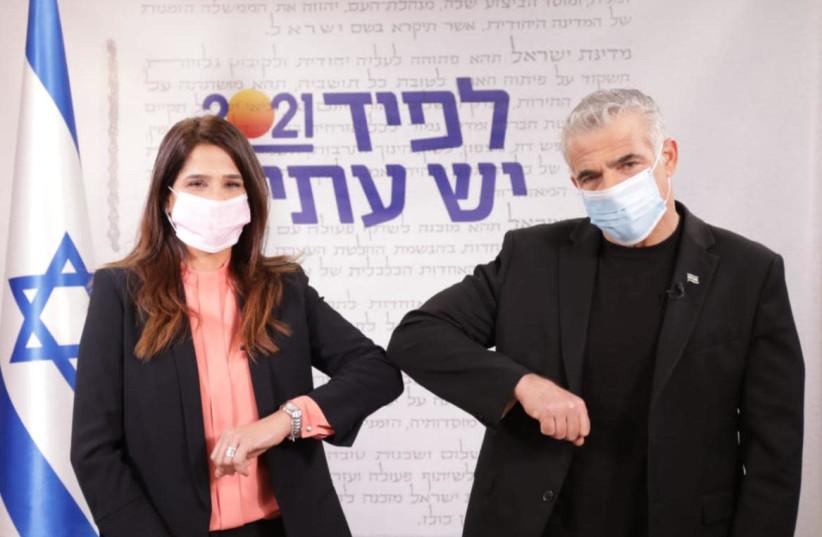 Merav Ben-Ari with Yesh Atid leader Yair Lapid, February 1, 2021 (photo credit: RAANAN COHEN)