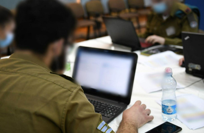 IDF cyber defenders are seen participating in an online international exercise. (photo credit: IDF)