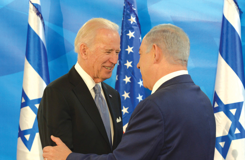 PRIME MINISTER Benjamin Netanyahu meets with then-US vice president Joe Biden in Jerusalem, in March 2016, There is 'history' between these two leaders that needs to be dealt with. (photo credit: AMOS BEN-GERSHOM/GPO)