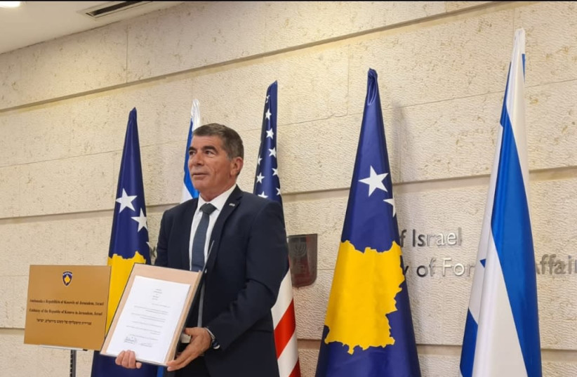 Foreign Minister Gabi Ashkenazi is seen with the agreement to form diplomatic ties with Kosovo in front of the Foreign Ministry in Jerusalem, on February 1, 2021. (photo credit: FOREIGN MINISTRY)