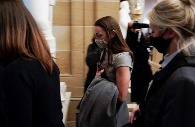 U.S. Rep. Alexandria Ocasio-Cortez (D-NY) walks through the U.S. Capitol, before the signature of the article of impeachment against U.S. President Donald Trump, in Washington, U.S. January 13, 2021 (photo credit: JOSHUA ROBERTS / REUTERS)