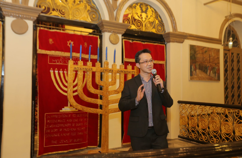 Myanmar Jewish community leader Sammy Samuels is seen addressing the synagogue during Hanukkah. (photo credit: JEWISH COMMUNITY OF MYANMAR)