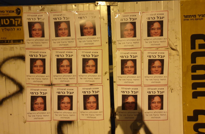 "Activists from Lotem, an organization that seeks to fight 'gender-based terror,' and from activist group ""Breaking Walls"" hung posters with the face of Yuval Karmi, a psychologist accused of sexually assaulting his patients, in the Jerusalem neighborhood where he lives. (photo credit: Courtesy)"