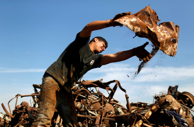 Gaza wasted scrap metals gains value as Israel clears exports (photo credit: MOHAMMED SALEM/ REUTERS)
