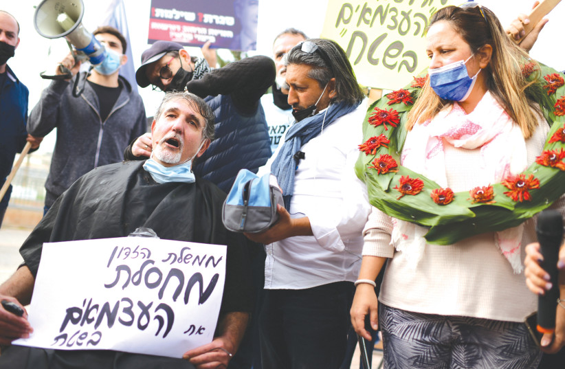 SMALL-BUSINESS owners protest coronavirus restrictions, in Holon, on January 31. (photo credit: TOMER NEUBERG/FLASH90)