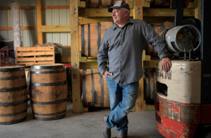 Former congressman Denver Riggleman in his barrel barn, where he ages spirits from the Virginia distillery that he co-owns with his wife, Nov. 20, 2020 (photo credit: JOHN MCDONNELL/THE WASHINGTON POST VIA GETTY IMAGES)