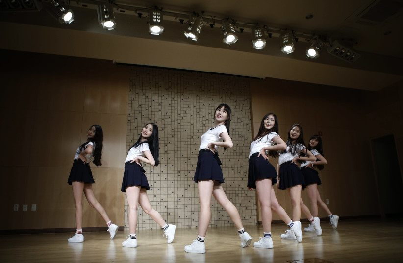 Members of South Korean girl group GFriend rehearse in Seoul (photo credit: KIM HONG-JI/ REUTERS)