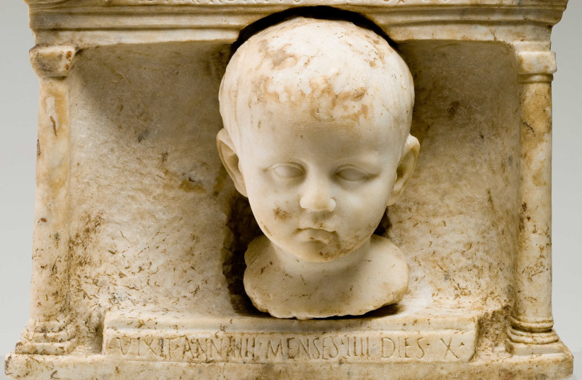 Marble funerary shrine with the four-year old child Tiberius Natronius Venustus.  (photo credit: VATICAN MUSEUM)