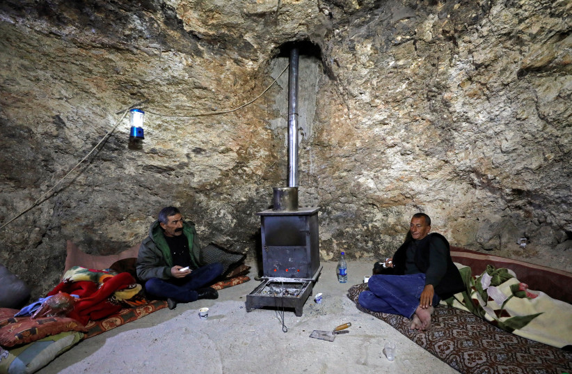 Palestinian cave-dwellers worry over Israeli settler incursions (photo credit: MUSSA QAWASMA/REUTERS)