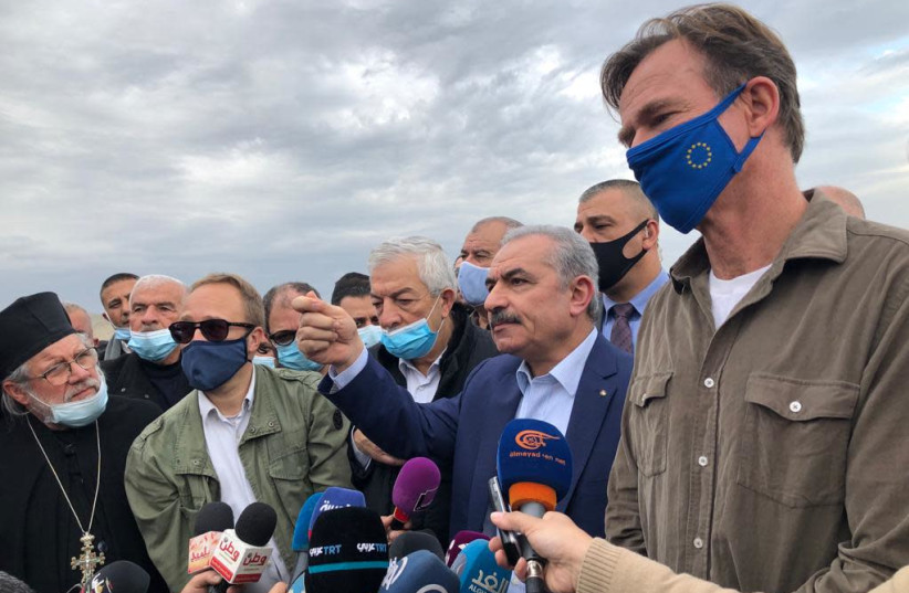 Palestinian Authority President Mohammed Shtayyeh is seen alongside EU Representative Sven Kühn von Burgsdorff is seen at the site of the illegal village of Khirbet Humsa, which the IDF demolished, on February 4, 2021. (photo credit: TOVAH LAZAROFF)