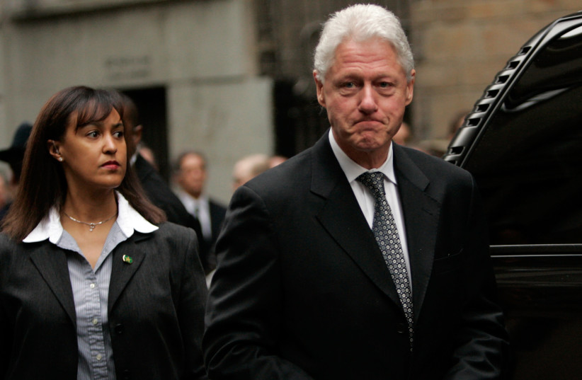 FORMER US president Bill Clinton leaves a memorial service for the wife of Charles Bronfman in New York in 2006. Bronfman has been a major donor for Birthright Israel and Jewish organizations.  (photo credit: REUTERS/KEITH BEDFORD)