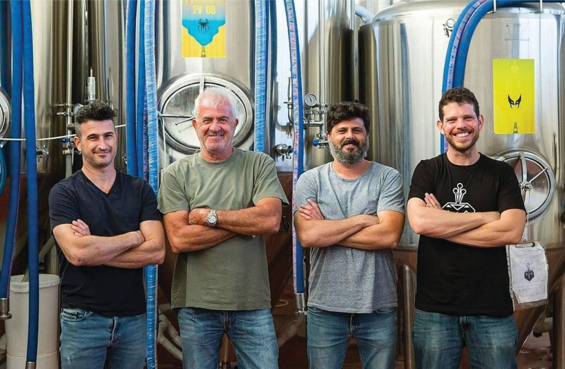 Team behind the four rare lemon beers brewed collaboratively by the BeerBazaar Brewery in Kiryat Gat and Klotsman Orchards in Emek Hefer (photo credit: ITIEL ZION)