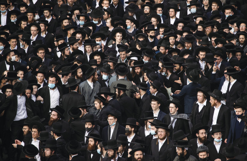 THE FUNERAL of Rabbi Meshulam Dovid Soloveitchik, on Sunday, in Jerusalem. The failure of haredi communities to come to terms with COVID-19, leading to extraordinary high rates of illness and death, requires soul-searching both internally and externally. (photo credit: YONATAN SINDEL/FLASH 90)