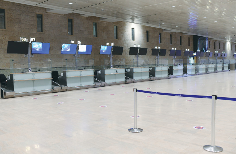 THE EMPTY departures hall at Ben-Gurion Airport this week. When will the skies open up and how long will it take until traveling is safe? (photo credit: TOMER NEUBERG/FLASH90)