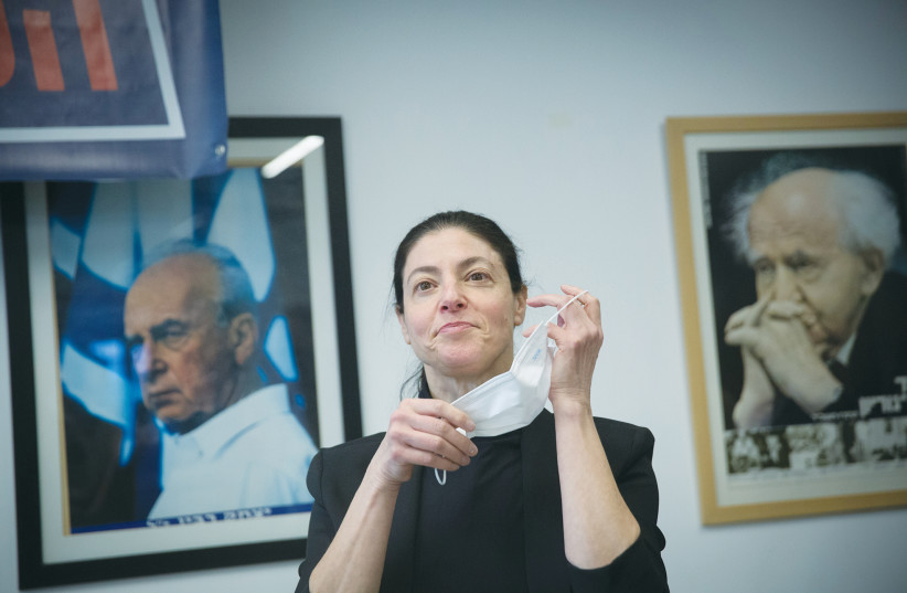 MERAV MICHAELI prepares to don a mask at a Labor Party polling station in Tel Aviv on January 24. (photo credit: MIRIAM ALSTER/FLASH90)