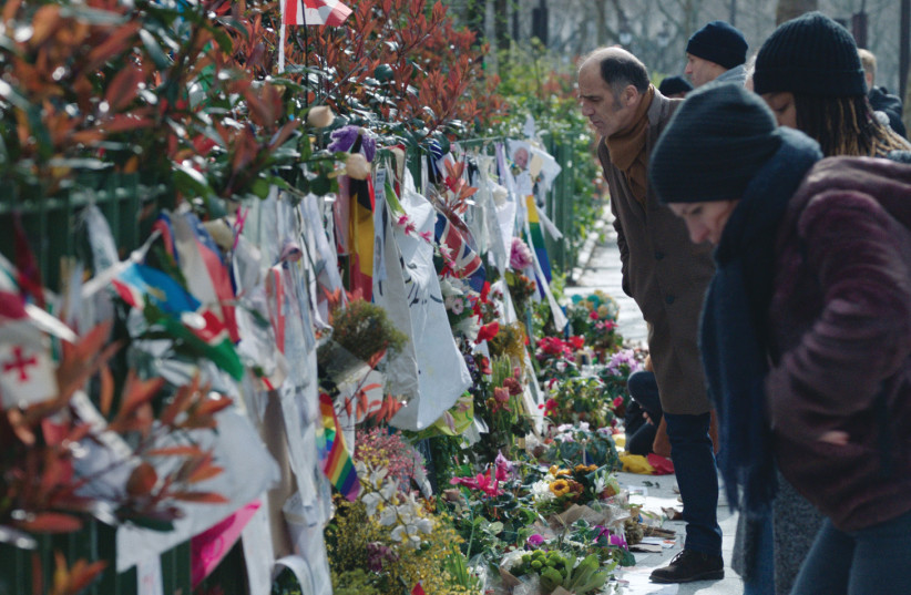 ACTOR FREDERIC Pierrot and others look at a memorial to victims of terrorism. (photo credit: @LES FILMS DU POISSON/CAROLE BETHUEL)
