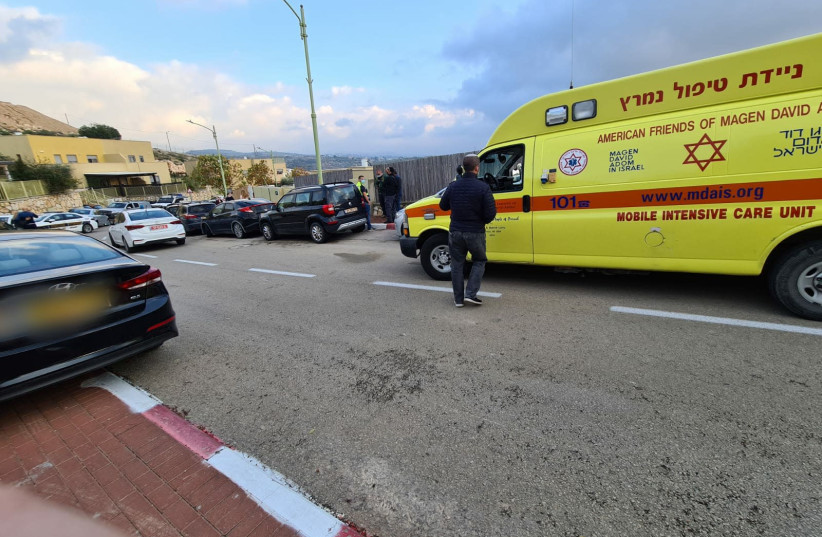An MDA ambulance stands outside the home of a woman who was seemingly murdered by her husband (photo credit: MAGEN DAVID ADOM)