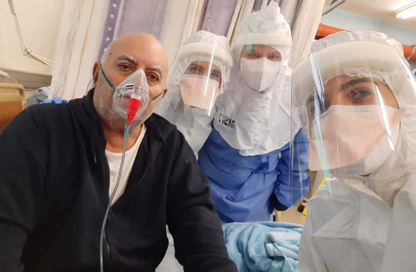 A patient is administered Prof. Nadir Arber's EXO-CD24 COVID-19 treatment (photo credit: ICHILOV SPOKESPERSON'S OFFICE)