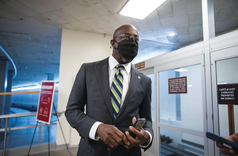 GEORGIA DEMOCRATIC Sen. Raphael Warnock departs following a vote in the basement of the US Capitol last month. (photo credit: AL DRAGO/REUTERS)