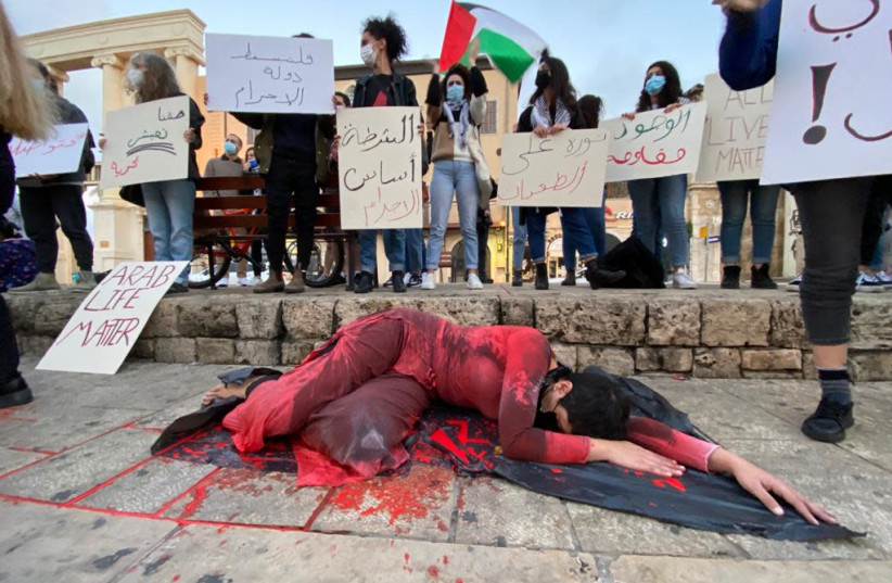 A protest against the rising crime and violence in the Arab sector in Israel, Jaffa, Saturday, February 6, 2021. (photo credit: SASSONI AVSHALOM)