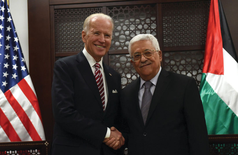 THEN-US VICE-PRESIDENT Joe Biden shakes hands with Palestinian Authority President Mahmoud Abbas in Ramallah in 2016. (photo credit: DEBBIE HILL/REUTERS)