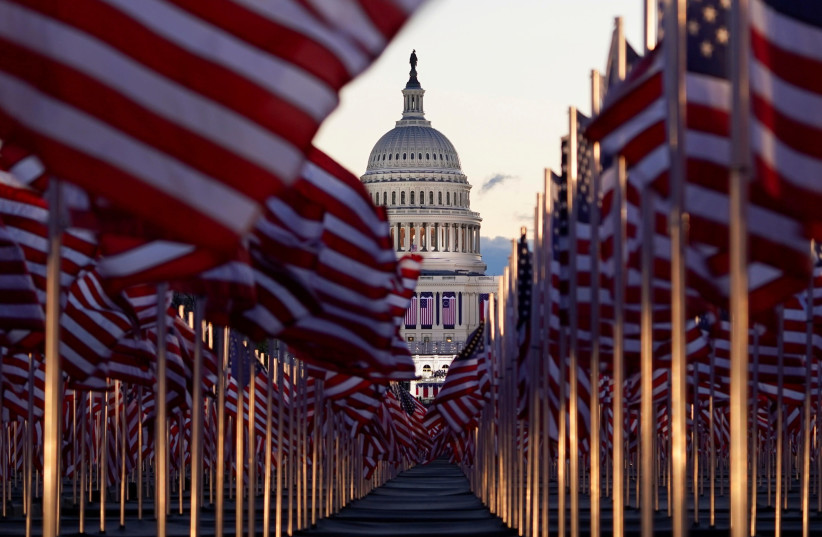 """The """"Field of flags"""" is seen on the National Mall in front of the US Capitol building ahead of inauguration ceremonies for President-elect Joe Biden in Washington, US, January 20, 2021. (photo credit: REUTERS/ALLISON SHELLEY)"""