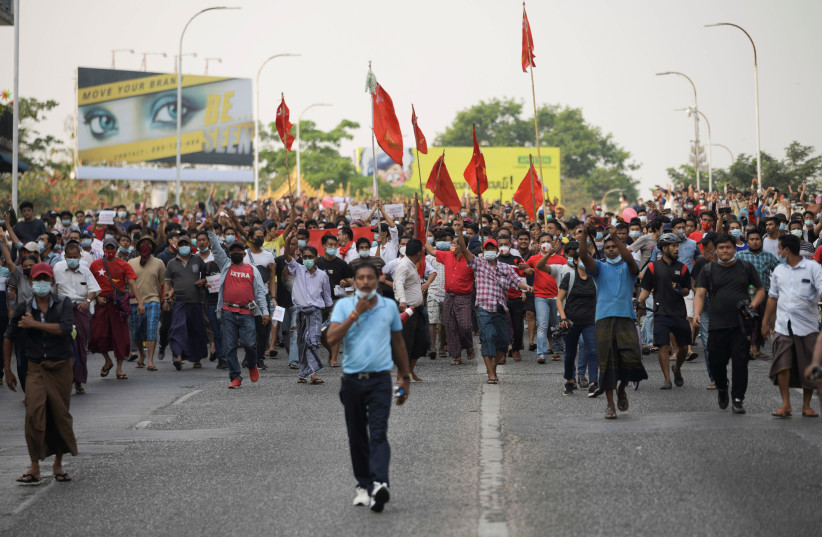 Demonstrators protest against the military coup and demand the release of elected leader Aung San Suu Kyi, in Yangon, Myanmar, February 6, 2021. (photo credit: REUTERS/STRINGER)