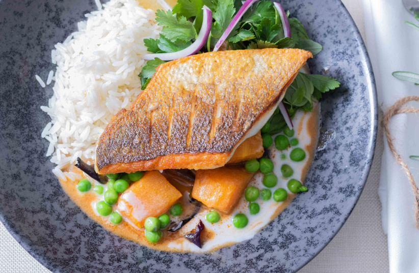 Fillet of fish over a bed of chestnut curry with pumpkin, peanut butter, peas and aromatic greens (photo credit: MARINA LEVDEV)