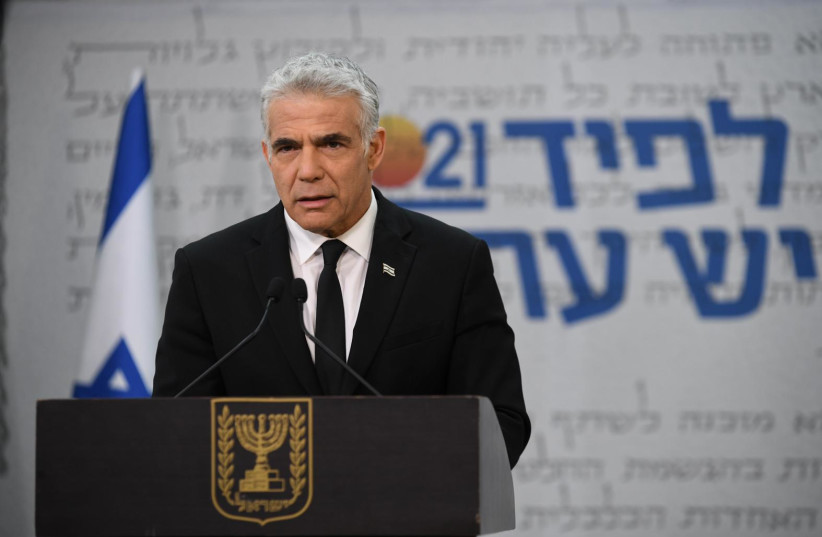 Yesh Atid leader Yair Lapid presents his party's plan for the elderly, February 7 ,2021 (photo credit: ELAD GUTMAN)