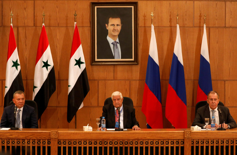 Russian Deputy Prime Minister Yuri Borisov, Foreign Minister Sergei Lavrov, and Syria's Foreign Minister Walid Muallem attend a press conference in Damascus, Syria, September 7, 2020 (photo credit: REUTERS/OMAR SANADIKI)