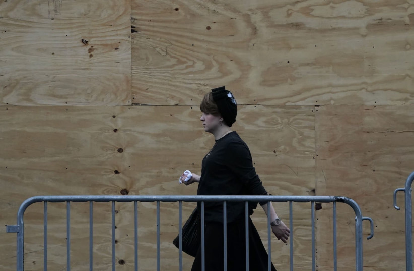 An Orthodox Jewish woman is seen in a Brooklyn neighborhood on September 29, 2020 in New York.  (photo credit: TIMOTHY A. CLARY / AFP)